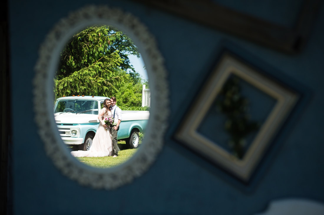 creative wedding photos, bride and groom portraits, reflection, vintage truck